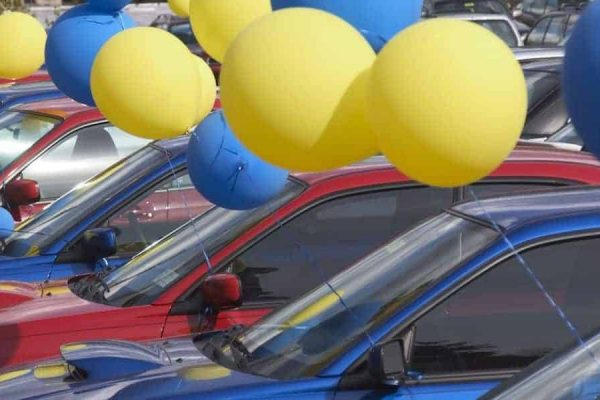 Car dealership with balloons