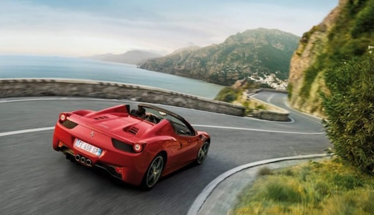 Driving abroad - preferably in this Ferrari on this road