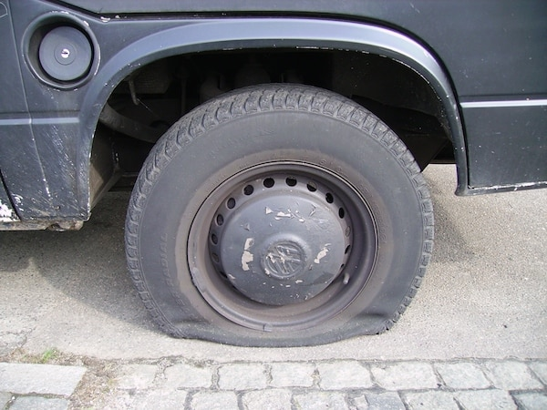 A flat tyre is a common car fault