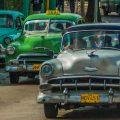 Cars driving along a road in Havana, Cuba