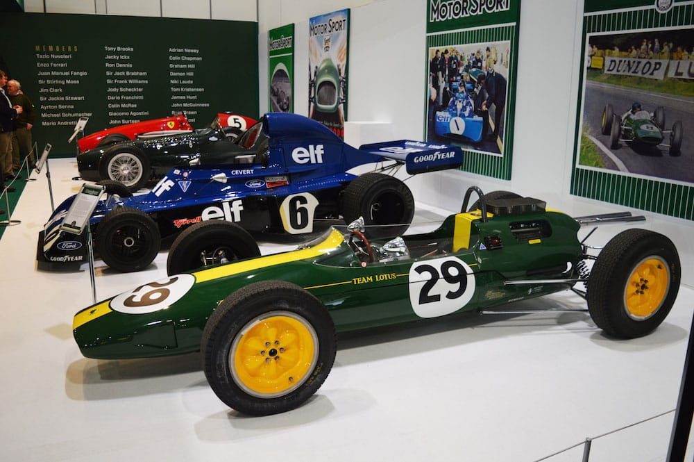 A Lotus 25 F1 car from 1963 fronts part of the Motor Sport magazine Hall of Fame display at the 2015 London Classic Car Show