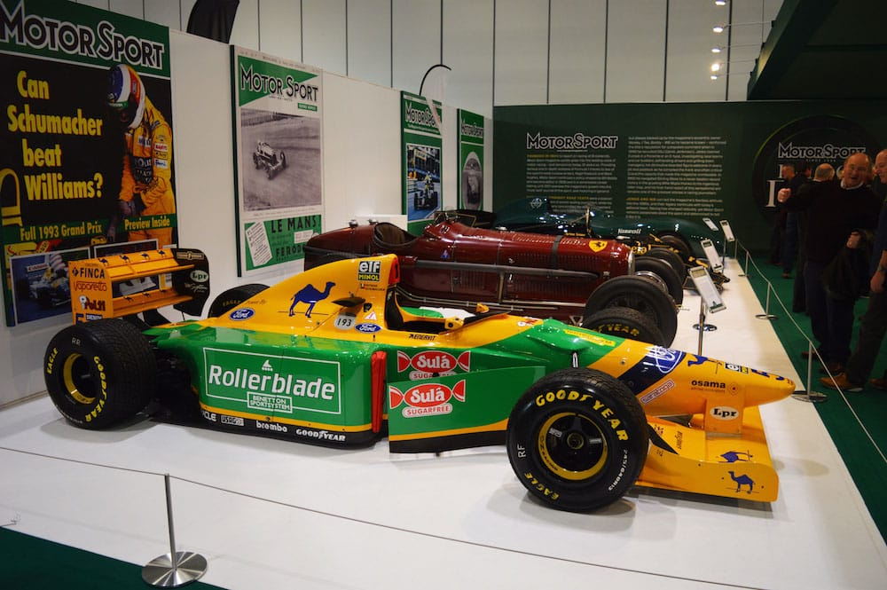 A Benetton B193 F1 car from 1993 fronts part of the Motor Sport magazine Hall of Fame display at the 2015 London Classic Car Show