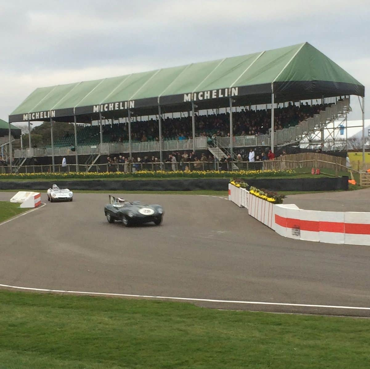 A Jaguar D-Type negotiates the chicane at the 73rd Goodwood Members' Meeting