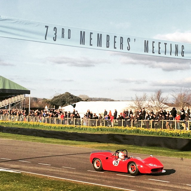 A McLaren M1B blasts along the pit straight at the 73rd Goodwood Members' Meeting