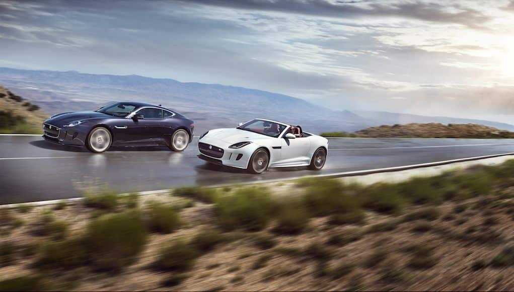 A Jaguar F-Type roadster overtaking its coupe sister