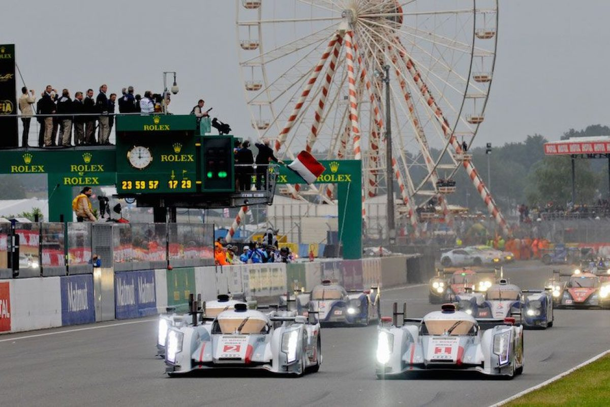 Start of the 2013 Le Mans 24 hours, with Audi leading Toyota across the line.