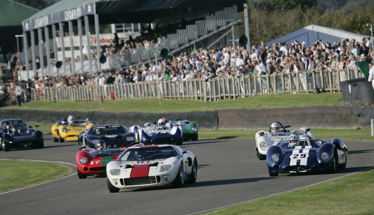 A Ford GT40 leads the pack into Turn 1 at the Goodwood Revival