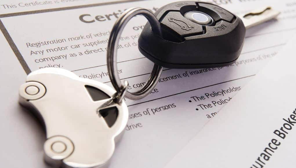 Car insurance application form, car key and keyring