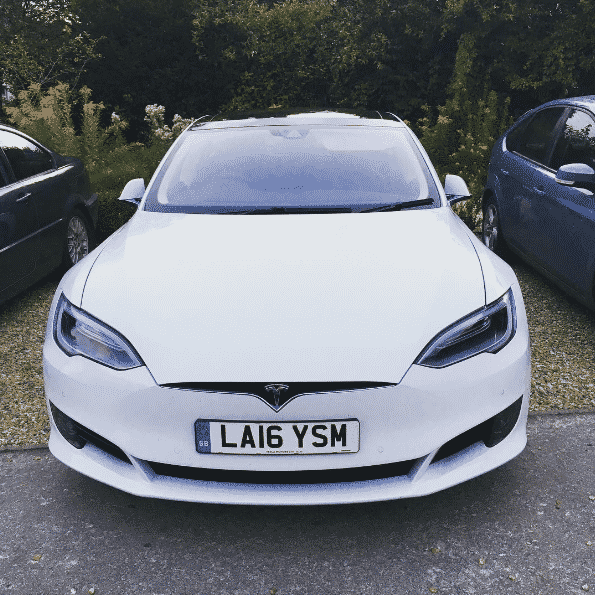 Tesla Model S from White Car in pub car park