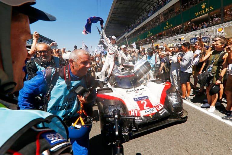 Porsche wins survival battle at Le Mans