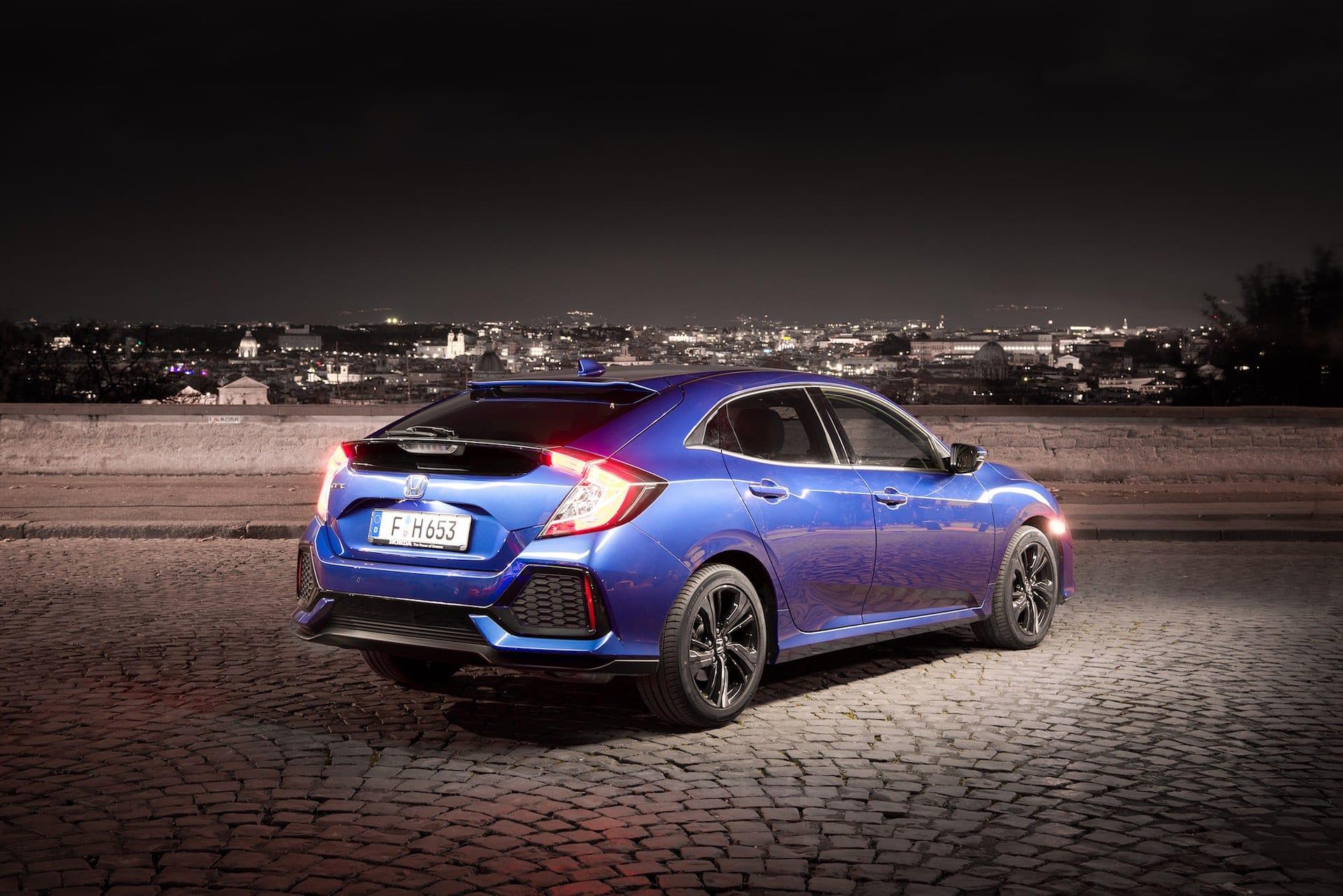 Honda Civic overlooking Rome at night