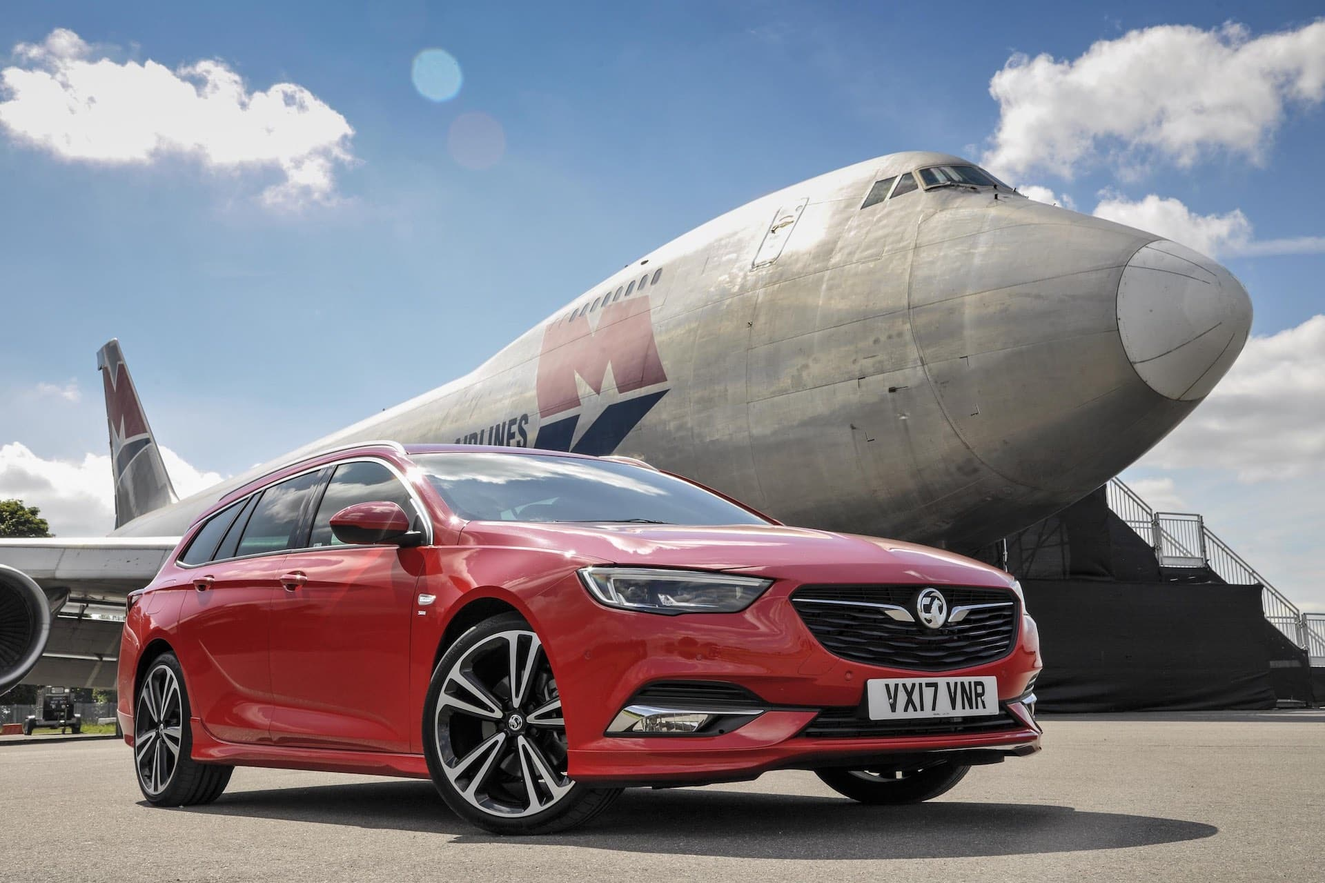 Vauxhall Insignia Sports Tourer in front of a Boeing 747