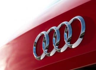 Audi four rings logo on red car | The Car Expert