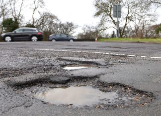 potholes in road in England