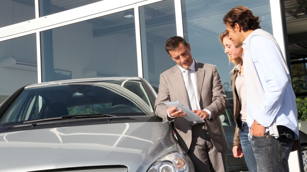 Discussing part-exchange price at the car dealership