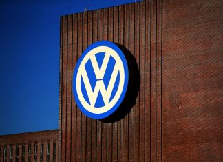 Volkswagen logo on the wall of its factory in Wolfstadt, Germany