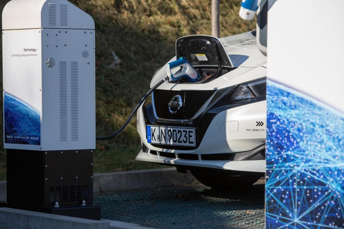 Nissan Leaf charging at a charging point | The Car Expert